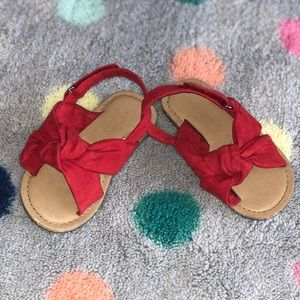 An adorable pair of cotton sandals.